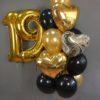 шары черные и золотые